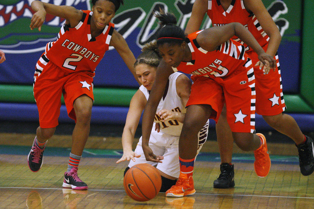 Chaparral guard Jasmine Martin, left, and Marcia Hawkins chase down a loose ball with Dimond guard Ne'chelle Martinez during their game at the Gator Winter Classic tournament Wednesday. Dimond won ...