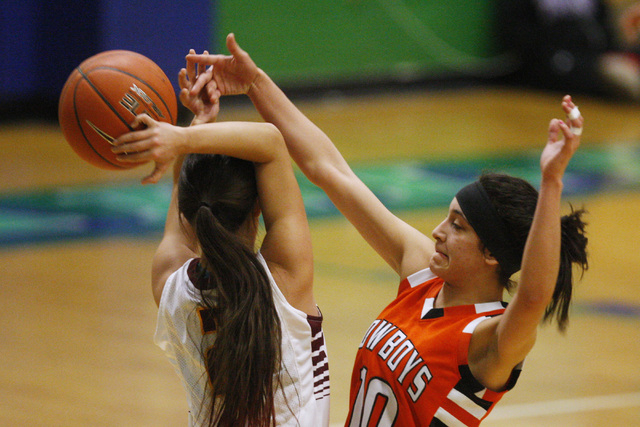 Chaparral guard Abigail Delgado swats the ball away from Dimond guard Tiffany Jackson during their game at the Gator Winter Classic tournament Wednesday at Green Valley. Delgado had 13 points for  ...