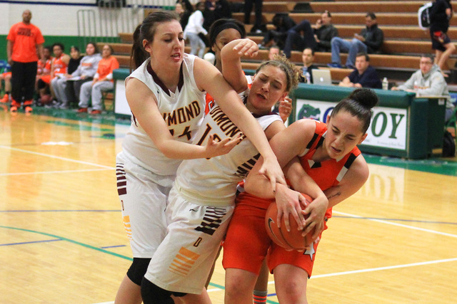 Dimond center Lexi Wingert, left, and guard Lauren Hines fight for a loose ball with Chaparral's Alexis Vanstory during their game at the Gator Winter Classic tournament Wednesday at Green Valley. ...