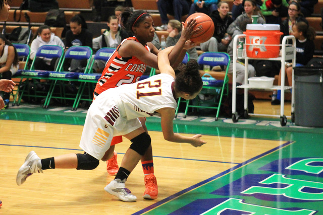 Chaparral guard Marcia Hawkins and Dimond guard Shameah Jones chase a loose ball during their game at the Gator Winter Classic tournament Wednesday at Green Valley. Dimond won the game in overtime ...