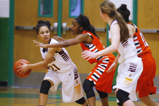 Chaparral guard Taij Criss-Felton defends Dimond guard Shameah Jones (21) during their game at the Gator Winter Classic tournament Wednesday. Criss-Felton had 16 points, but the Cowboys fell 59-57 ...