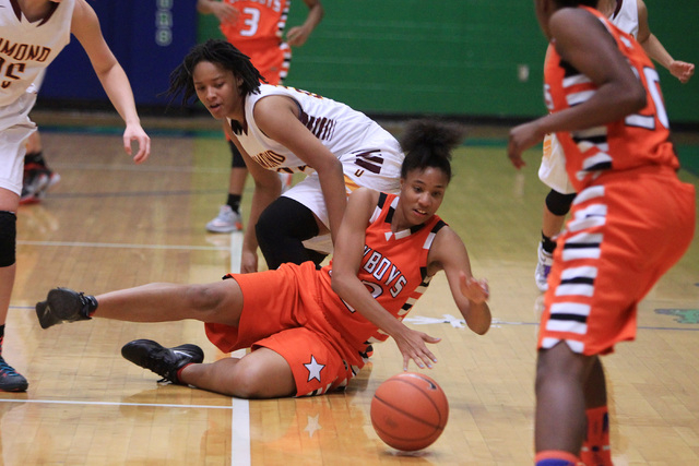 Chaparral center Jade Hazelton rolls a loose ball away from Dimond during the Gator Winter Classic Wednesday at Green Valley High School. Hazelton had 23 rebounds, but Dimond won the game in overt ...