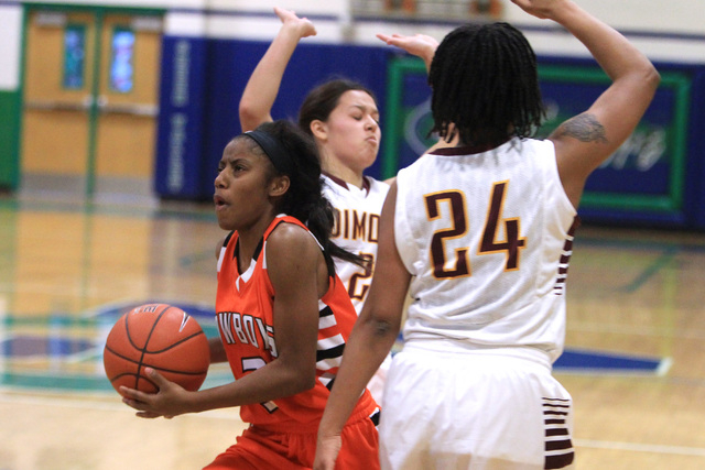 Chaparral guard Taij Criss-Felton drives between Dimond guards Tiffany Jackson and Dejha Canty (24) during their game at the Gator Winter Classic tournament Wednesday. Criss-Felton had 16 points,  ...