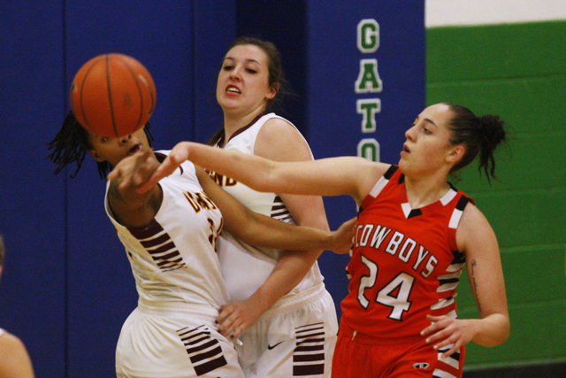 Chaparral guard Alexis Vanstory swats the ball away from Dimond guard Dejha Canty during their game at the Gator Winter Classic tournament Wednesday at Green Valley. Canty had 15 points as Dimond  ...