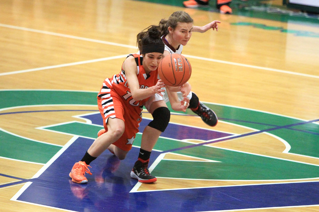 Chaparral guard Abigail Delgado and Dimond guard Nikki Forrey chase a loose ball during their game at the Gator Winter Classic tournament Wednesday at Green Valley. Dimond won the game in overtime ...