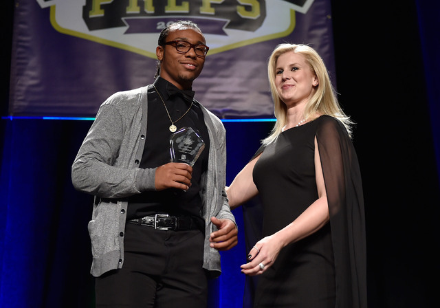 Chaparral High School's Richard Nelson, left, receives his courage award during the Best of Nevada Preps awards banquet at the Red Rock hotel-casino Saturday, June 4, 2016, in Las Vegas. (David Be ...
