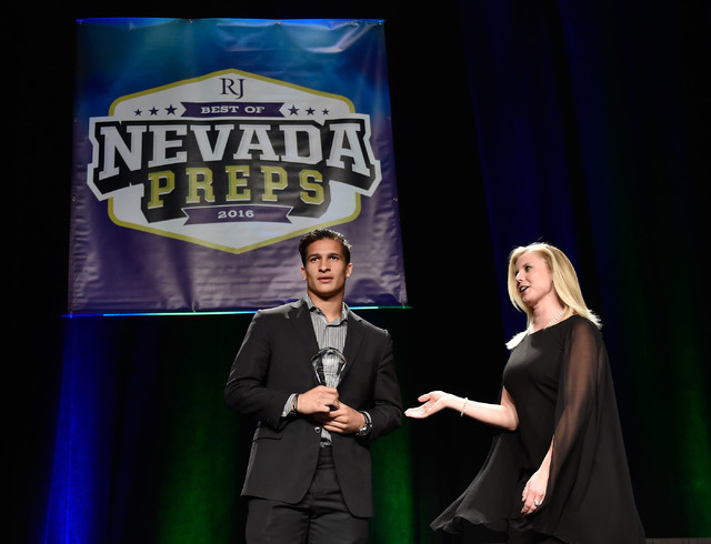 Bishop Gorman's Biaggio Ali Walsh, left receives his top male athlete award at the Best of Nevada Preps awards banquet at the Red Rock hotel-casino Saturday, June 4, 2016, in Las Vegas. (David Bec ...