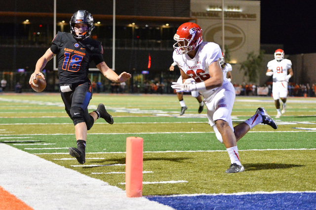 Bishop Gorman quarterback Tate Martell (18) ducks out of bounds short of the goal line during the Bishop Gorman High School Kahuku High School game at Bishop Gorman in Summerlin on Saturday, Sept. ...