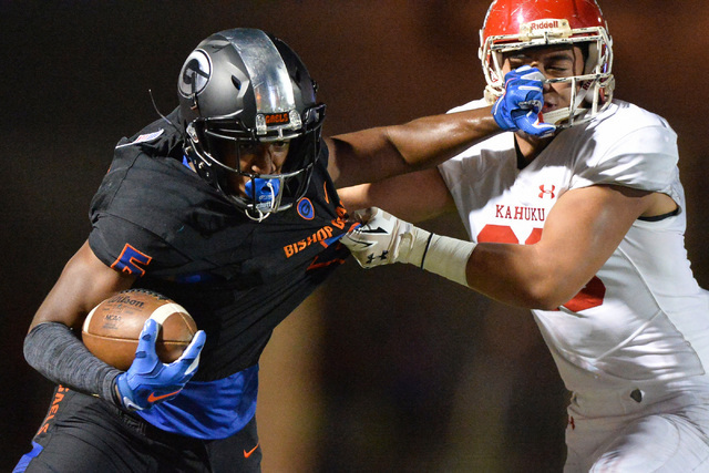 Bishop Gorman receiver Austin Arnold (6) stiff arms Kahuku's Kesi Ah Hoy (26)  during the Bishop Gorman High School Kahuku High School game at Bishop Gorman in Summerlin on Saturday, Sept. 17, 201 ...