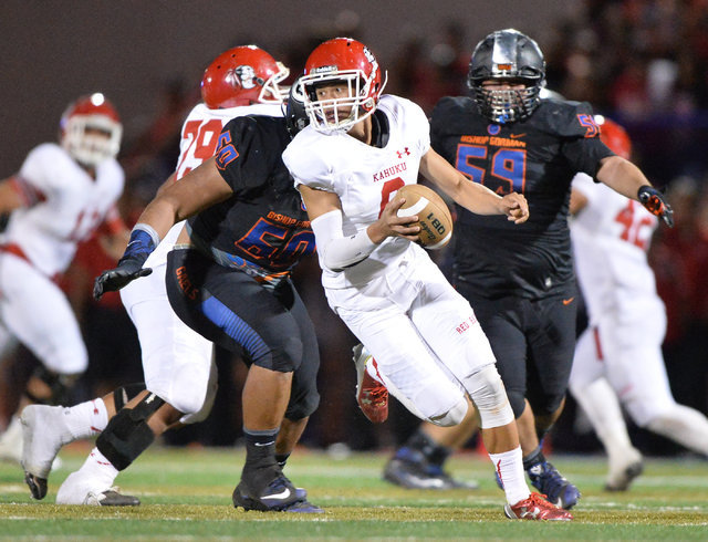 Kahuku quarterback Sol-jay Maiava (6) scrambles out of the pocket during the Bishop Gorman High School Kahuku High School game at Bishop Gorman in Summerlin on Saturday, Sept. 17, 2016. Brett Le B ...