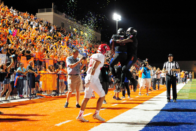 Bishop Gorman receivers Austin Arnold (6) and Brevin Jordan (9) celebrate a touchdown during the Bishop Gorman High School Kahuku High School game at Bishop Gorman in Summerlin on Saturday, Sept.  ...