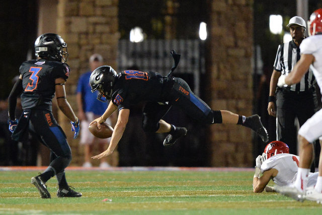 Bishop Gorman quarterback Tate Martell (18) is tackled during the Bishop Gorman High School Kahuku High School game at Bishop Gorman in Summerlin on Saturday, Sept. 17, 2016. Brett Le Blanc/Las Ve ...
