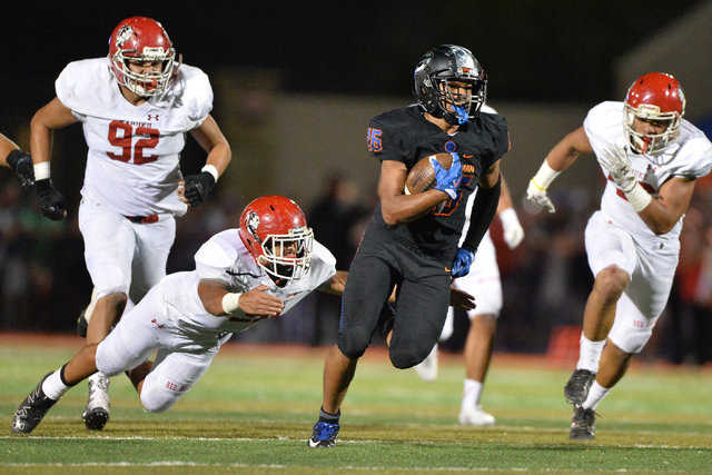 Bishop Gorman running back Amod Cianelli (26) carries the football during the Bishop Gorman High School Kahuku High School game at Bishop Gorman in Summerlin on Saturday, Sept. 17, 2016. Brett Le  ...