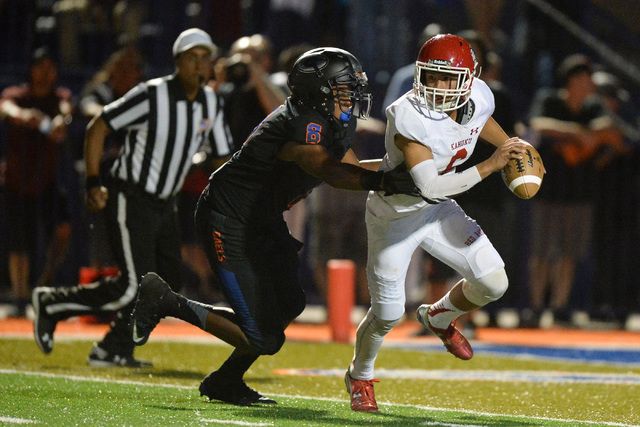 Kahuku quarterback Sol-jay Maiava (6) is sacked by Bishop Gorman defensive end Adam Plant (8) during the Bishop Gorman High School Kahuku High School game at Bishop Gorman in Summerlin on Saturday ...
