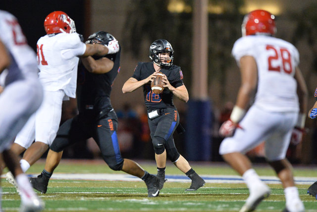 Bishop Gorman quarterback Tate Martell (18) looks for an open receiver during the Bishop Gorman High School Kahuku High School game at Bishop Gorman in Summerlin on Saturday, Sept. 17, 2016. Brett ...