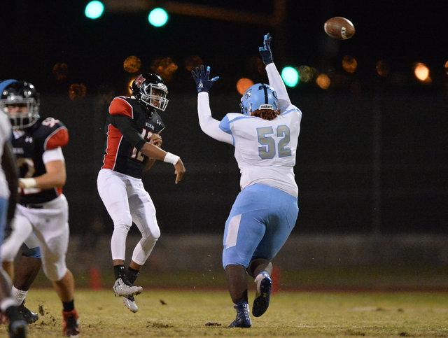 Las Vegas quarterback Zach Matlock (12) throws a pass over Canyon Springs defensive tackle A.J. Davis (52) during the Las Vegas High School Canyon Springs High School game at Las Vegas High School ...