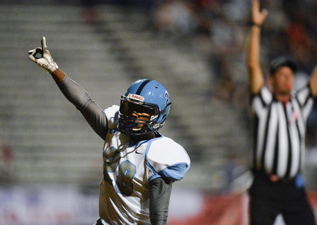 Canyon Springs receiver Karon Woods (28) celebrates scoring a touchdown during the Las Vegas High School Canyon Springs High School game at Las Vegas High School on Friday, Oct. 7, 2016. Brett Le  ...