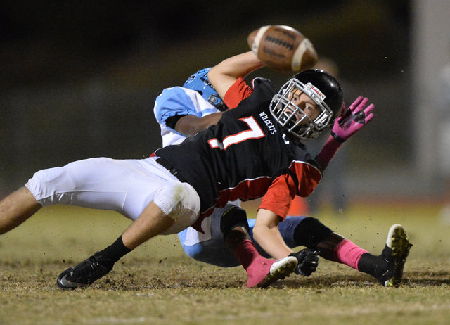Las Vegas receiver Cody Kludasch (7) keeps his eye on the ball as a broken up pass falls to the ground during the Las Vegas High School Canyon Springs High School game at Las Vegas High School on  ...