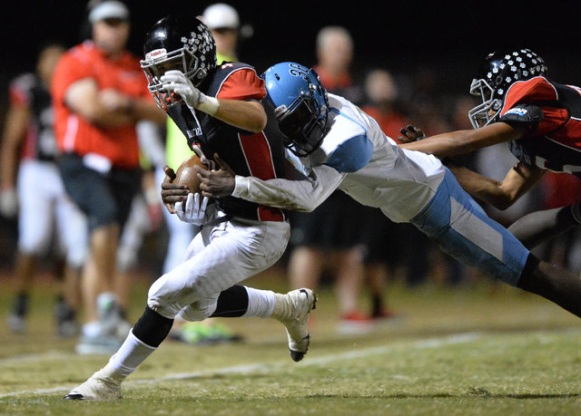 Las Vegas receiver Nick Sablan (4) is tackled out of bounds during the Las Vegas High School Canyon Springs High School game at Las Vegas High School on Friday, Oct. 7, 2016. Brett Le Blanc/Las Ve ...