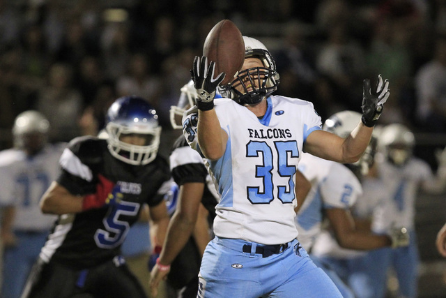 Foothill linebacker Josh Hughes grabs a missed Basic field goal attempt during the first half on Friday. Hughes nearly made it back to the goal line before being tackled as time expired. (Sam Morr ...