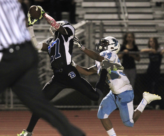 Basic wide receiver Josh Villaros pulls in a touchdown pass while being covered by Foothill defensive back Justice Jackson during the first half on Friday.  (Sam Morris/Las Vegas Review-Journal)