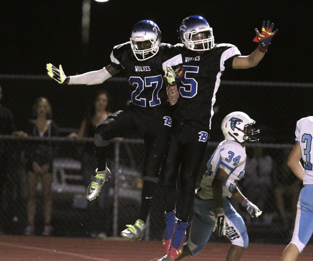 Basic wide receiver Josh Villaros, left, and wide receiver Tayj'ean Thomas celebrate Villaros' first-half touchdown catch against Foothill on Friday.  (Sam Morris/Las Vegas Review-Journal)
