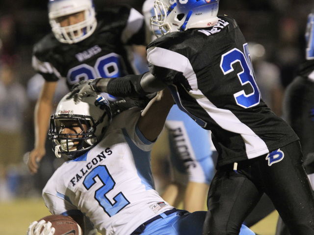 Basic defensive end Wallonzo Whipple stops Foothill running back Bobby Merritt during the first half on Friday.  (Sam Morris/Las Vegas Review-Journal)