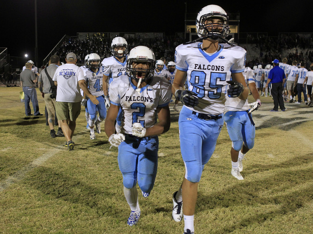 Foothill's Bobby Merritt, left, and Tyler Jacob celebrate their 34-30 defeat of Basic on Friday. Merritt had an 87-yard kickoff return for a touchdown and scored the go-ahead TD on a 6-yard run wi ...