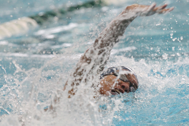 Legacy swimmer Isiah Magsino swims the anchor leg of the 400 freestyle relay during a meet Saturday, April 25, 2015. (Sam Morris/Las Vegas Review-Journal) Follow Sam Morris on Twitter @sammorrisRJ