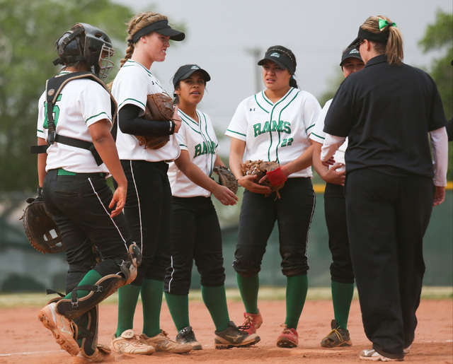 Samantha Pochop (72), second from left, meets with her team in the pitchers circle during a game between the Rancho High School Rams and the Green Valley High School Gators on Monday, March 28, 20 ...