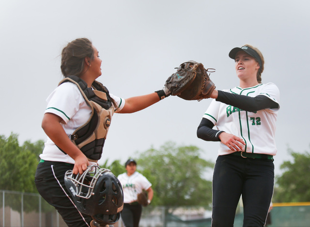 Samantha Pochop (72), right, high-fives the catcher after ending an inning during a game between the Rancho High School Rams and the Green Valley High School Gators on Monday, March 28, 2016, in L ...