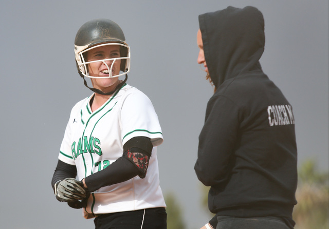 Samantha Pochop (72) cracks a smile after getting a base hit during a game between the Rancho High School Rams and the Green Valley High School Gators on Monday, March 28, 2016, in Las Vegas. Bret ...