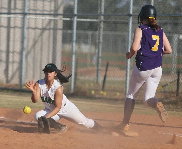 Rancho's Sammi Llamas, left, tries to record an out as Durango's Cheyanne Haas reaches first base. Rancho defeated Durango, 7-0. (Ronda Churchill/Las Vegas Review-Journal)