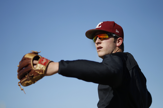 Faith Lutheran pitcher Brandon Johnson warms up at practice on Tuesday. Johnson was 8-2 with a 1.64 ERA last season. (John Locher/Las Vegas Review-Journal)