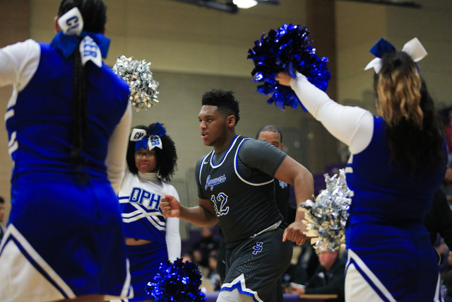 Desert Pines senior Jalen Graves (12) runs onto the court during the Class 3A boys regional basketball final between Desert Pines High School and Cheyenne High School at Sunrise High School in Las ...