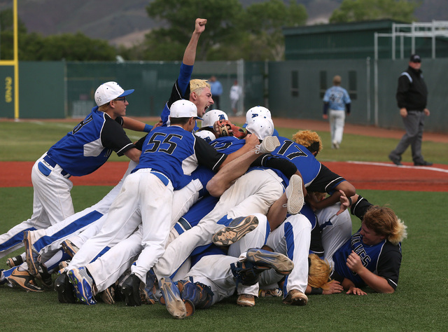 The Basic Wolves celebrate their 9-1 win over Centennial for the NIAA DI baseball championship at Bishop Manogue High School in Reno, Nev., on Saturday, May 21, 2016. Cathleen Allison/Las Vegas Re ...