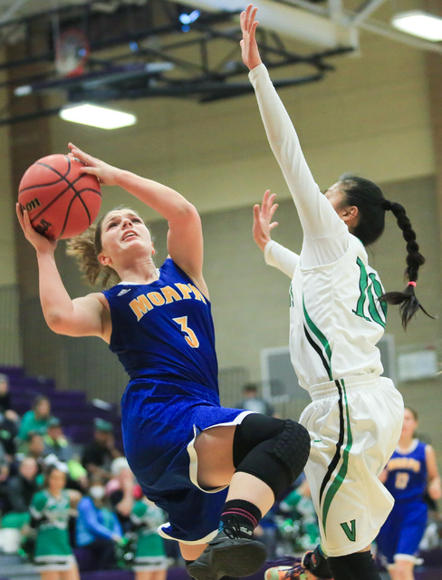 Moapa Valley sophomore Lainey Cornwall (3) shoots the ball during the Class 1A girls regional basketball final between Moapa Valley High School and Virgin Valley High School at Sunrise High School ...