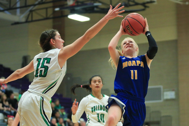 Moapa Valley freshman Kaitlyn Anderson (11) shoots the ball during the Class 1A girls regional basketball final between Moapa Valley High School and Virgin Valley High School at Sunrise High Schoo ...