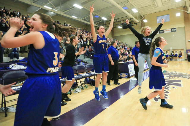 The Moapa Valley High School Pirates celebrate beating Virgin Valley High School in the Class 1A girls regional basketball final at Sunrise High School in Las Vegas on Saturday, Feb. 18, 2017. Bre ...