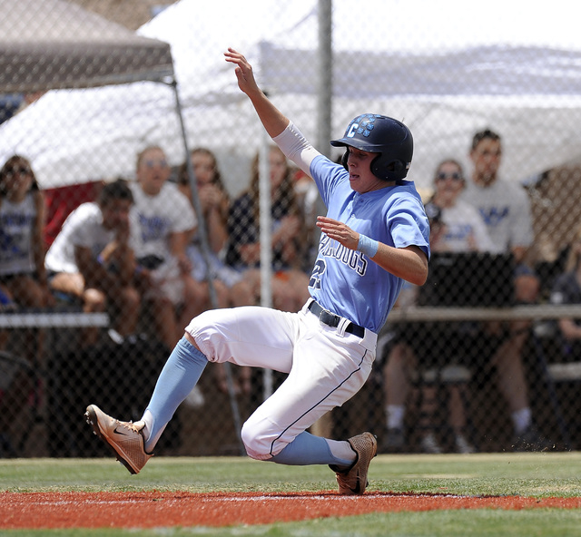 Centennial outfielder Ricky Koplow scores the first run of the game against the Bishop Gorman in the first inning of the Sunset Region title game on Saturday. The Bulldogs scored three times in th ...