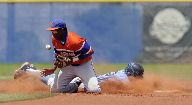 Bishop Gorman second baseman Andrew Newson bobbles the throw as Centennial's Travis Stevens dives back to second base in the second inning of the Sunset Region championship game on Saturday. (Josh ...