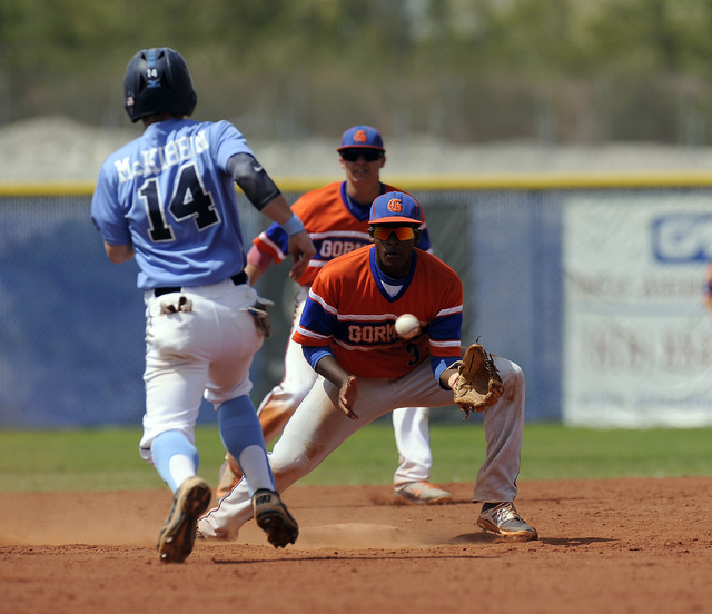 Bishop Gorman second baseman Andrew Newson awaits a throw as Josh McKibbin steals second base in the sixth inning on Saturday. Centennial beat Gorman 3-1 for the Sunset Region title. (Josh Holmber ...