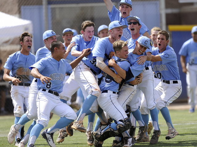 Centennial players celebrate after defeating Bishop Gorman 3-1 in the Sunset Region championship game on Saturday. (Josh Holmberg/Las Vegas Review Journal)