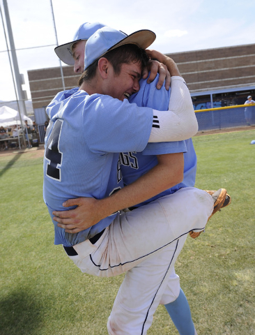 Centennial's Jake Portaro, left, and Will Loucks embrace after the Bulldogs defeated Bishop Gorman in the Sunset Region title game on Saturday. The Bulldogs open play in the Division I state tourn ...