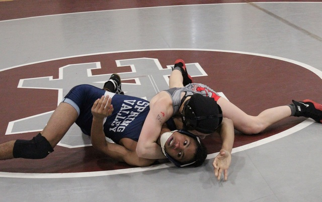 Arbor View 106-pounder Peyton Prussin works on top of Spring Valley's Bryan Hermida in the opening round of the Sunset Region wrestling tournament at Cimarron-Memorial on Friday. (W.G. Ramirez/Las ...