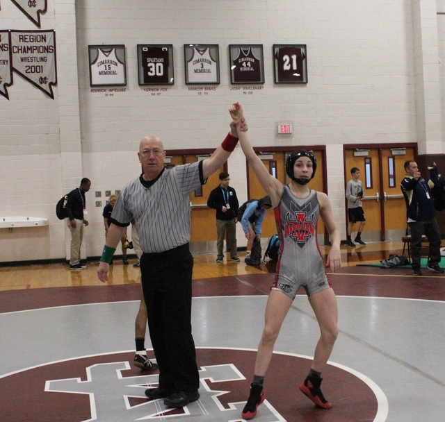Referee Mike Guerino raises the arm of Arbor View 106-pounder Peyton Prussin after winning her first match in the opening round of the Sunset Region wrestling tournament at Cimarron-Memorial on Fr ...