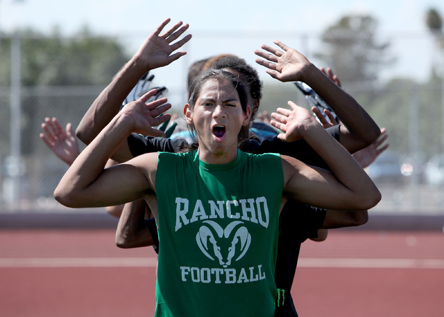 "Rancho quarterback Yasser Rebolledo does a ""Ram-Jack"" during practice at Rancho High on Thursday. The team will play an independent schedule this fall. They have not had a victory since 2011, and  ..."
