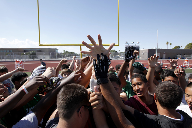 Rancho High School football players huddle during practice on Thursday. The team will play an independent schedule this fall. They have not had a victory since 2011, and the team hopes that playin ...