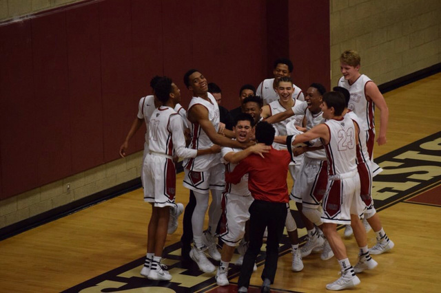 Desert Oasis' Ron Chan is mobbed by teammates after scoring his first points of the season against Bonanza. (Courtesy photo)