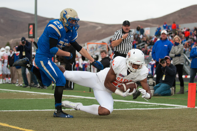 Bishop Gorman's Cordell Broadus (21) catches a touchdown pass against Reed's Porter Hansen (23) during the second half of Saturday's state championship game in Reno. Broadus caught three passes fo ...
